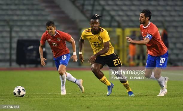 Belgium's forward Michy Batshuayi vies for the ball with Costa Rica's defender Cristian Gamboa and Costa Rica's forward Bryan Ruiz during the...
