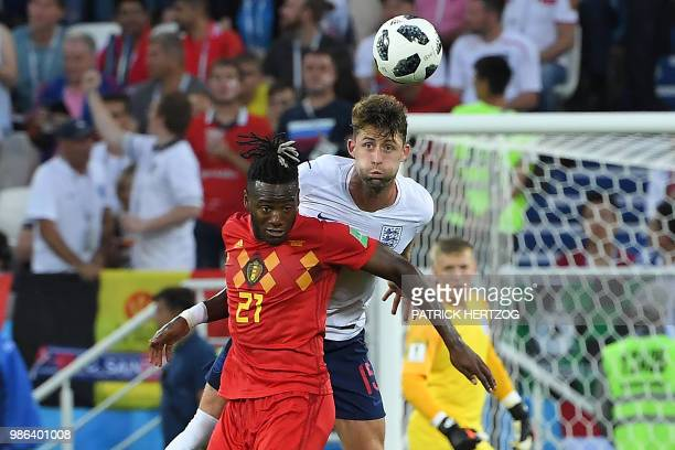 Belgium's forward Michy Batshuayi vies with England's defender Gary Cahill during the Russia 2018 World Cup Group G football match between England...