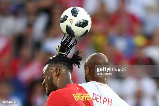 Belgium's forward Michy Batshuayi vies with England's midfielder Fabian Delph during the Russia 2018 World Cup Group G football match between England...