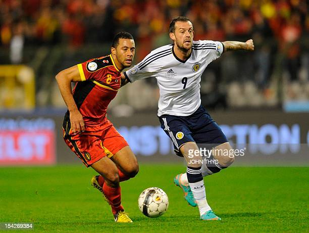 Belgium's forward Moussa Dembele vies for the ball with Steven Fletcher of Scotland during the 2014 World Cup qualifying football match between...