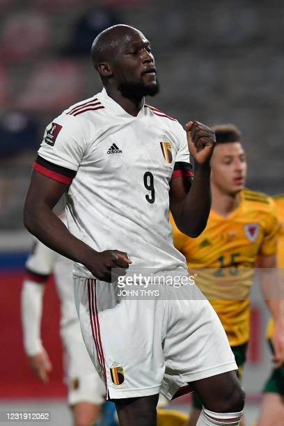 Belgium's forward Romelu Lukaku celebrates after scoring on a penalty kick during the FIFA World Cup Qatar 2022 qualification football match between...