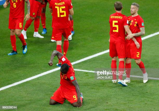 TOPSHOT Belgium's forward Romelu Lukaku celebrates next to teammates at the end of the Russia 2018 World Cup round of 16 football match between...