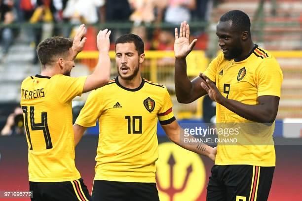Belgium's forward Romelu Lukaku celebrates with a teammates Belgium's forward Dries Mertens and Belgium's forward Eden Hazard after scoring a goal...