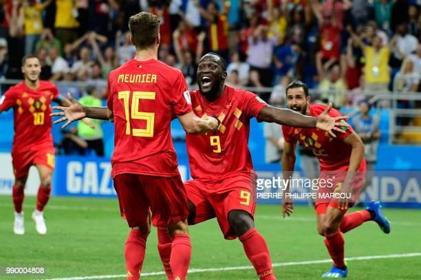 Belgium's forward Romelu Lukaku celebrates with Belgium's defender Thomas Meunier after Belgium's midfielder Nacer Chadli scored his team's third...