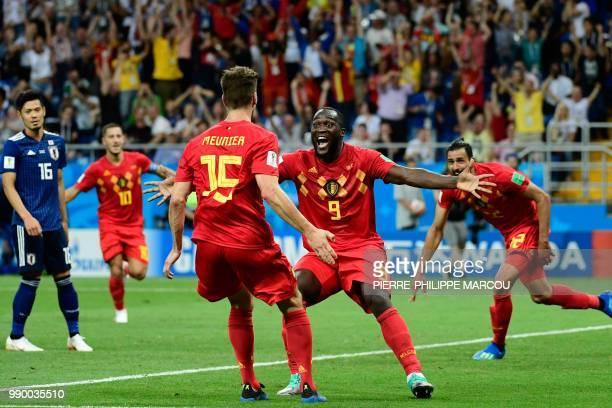 TOPSHOT Belgium's forward Romelu Lukaku celebrates with Belgium's defender Thomas Meunier after Belgium's midfielder Nacer Chadli scored his team's...