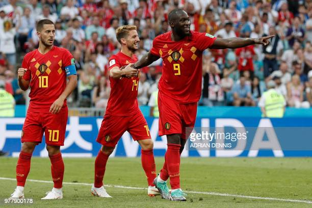 TOPSHOT Belgium's forward Romelu Lukaku celebrates with Belgium's forward Dries Mertens and Belgium's forward Eden Hazard after scoring a goal during...