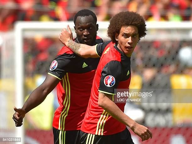 TOPSHOT Belgium's forward Romelu Lukaku celebrates with Belgium's midfielder Axel Witsel after scoring a goal during the Euro 2016 group E football...