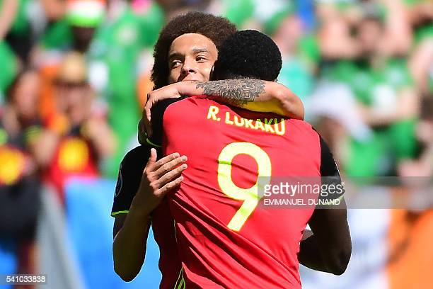 TOPSHOT Belgium's forward Romelu Lukaku celebrates with Belgium's midfielder Axel Witsel after scoring his team's third goal during the Euro 2016...