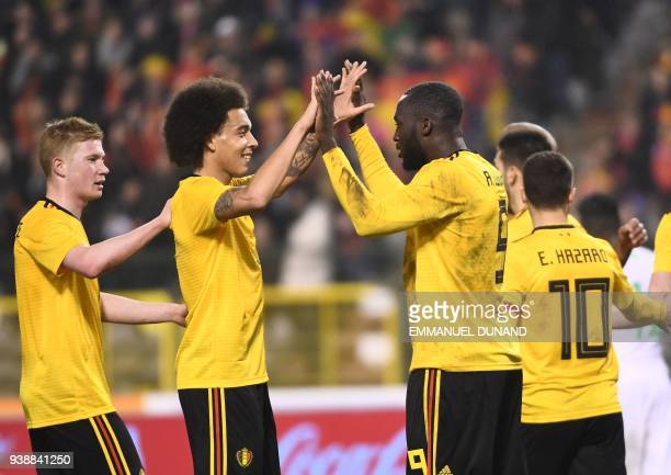 Belgium's forward Romelu Lukaku celebrates with Belgium's midfielder Axel Witsel and Belgium's midfielder Kevin De Bruyne after scoring his second...