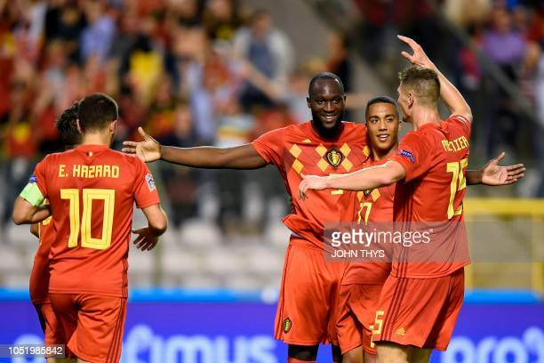 Belgium's forward Romelu Lukaku celebrates with his teammates after scoring during the UEFA Nations League football match between Belgium and...