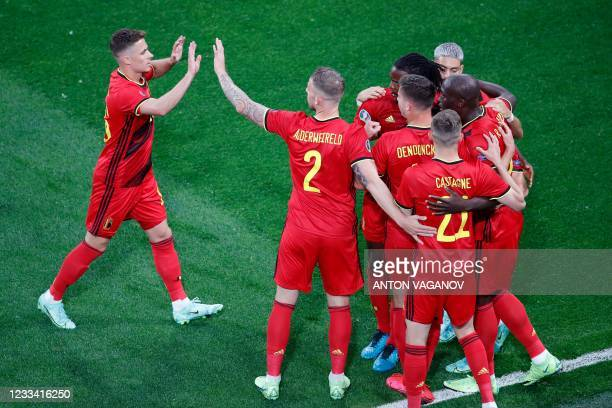 Belgium's forward Romelu Lukaku celebrates with teammates after scoring his team's first goal during the UEFA EURO 2020 Group B football match...