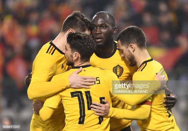 Belgium's forward Romelu Lukaku celebrates with teammates after scoring his second goal during a friendly international match between Belgium and...