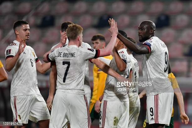 Belgium's forward Romelu Lukaku celebrates with teammates after scoring on a penalty kick during the FIFA World Cup Qatar 2022 qualification football...