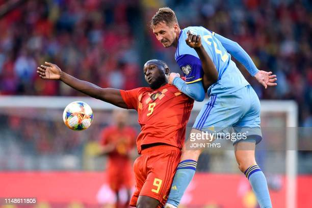Belgium's forward Romelu Lukaku fights for the ball with Kazakhstan's defender Sergei Maliy during the UEFA Euro 2020 qualification football match...