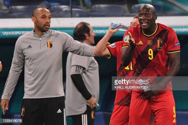 Belgium's forward Romelu Lukaku gestures next to Belgium's French assistant coach Thierry Henry during the UEFA EURO 2020 Group B football match...