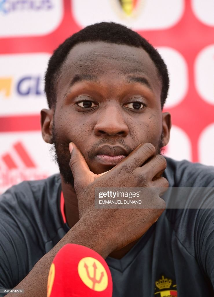 Belgium's forward Romelu Lukaku gives a press conference during the Euro 2016 football tournament at Le Haillan, western France, on June 23, 2016. / AFP / EMMANUEL