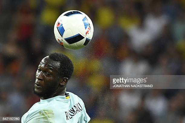 Belgium's forward Romelu Lukaku heads the ball during the Euro 2016 group E football match between Sweden and Belgium at the Allianz Riviera stadium...