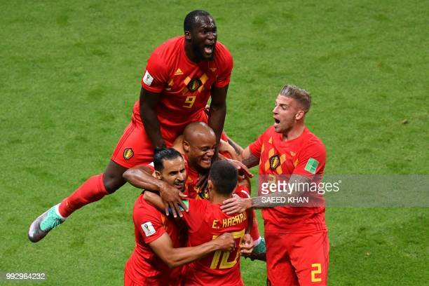 Belgium's forward Romelu Lukaku jumps over teammates to celebrate Brazil's own goal during the Russia 2018 World Cup quarterfinal football match...