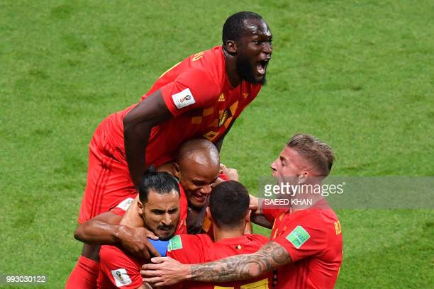 TOPSHOT Belgium's forward Romelu Lukaku jumps over teammates to celebrate Brazil's own goal during the Russia 2018 World Cup quarterfinal football...