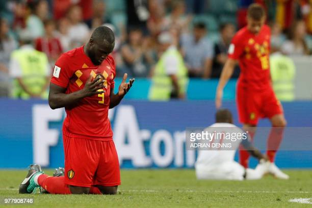 TOPSHOT Belgium's forward Romelu Lukaku prays at the end of the Russia 2018 World Cup Group G football match between Belgium and Panama at the Fisht...