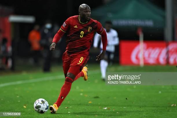 Belgium's forward Romelu Lukaku runs with the ball during the UEFA Nations League football match between Belgium and England, on November 15, 2020 at...