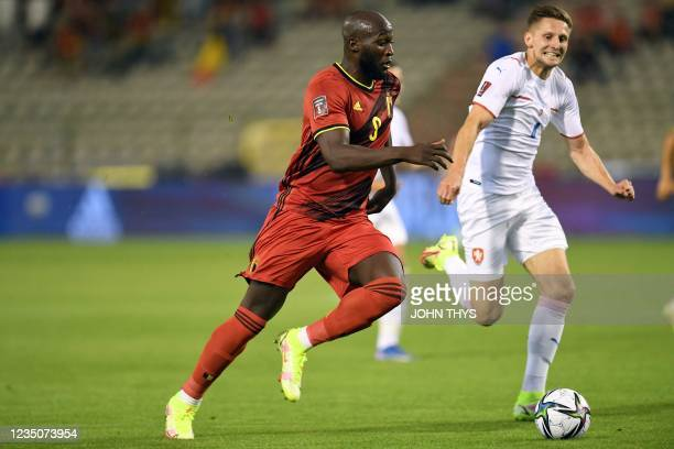 Belgium's forward Romelu Lukaku scores during the FIFA World Cup Qatar 2022 qualifying round Group E football match between Belgium and Czech...