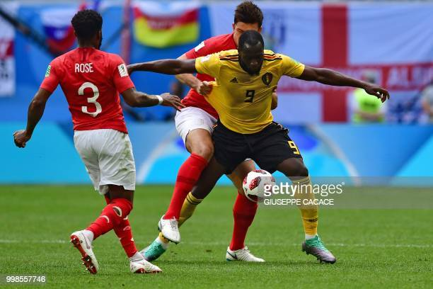 Belgium's forward Romelu Lukaku vies with England's defender Harry Maguire during their Russia 2018 World Cup playoff for third place football match...