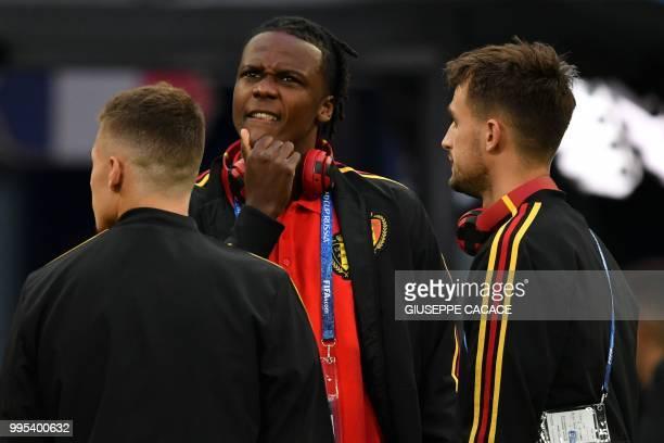 Belgium's forward Thorgan Hazard Belgium's defender Dedryck Boyata and Belgium's forward Adnan Januzaj gather on the pitch ahead of the Russia 2018...