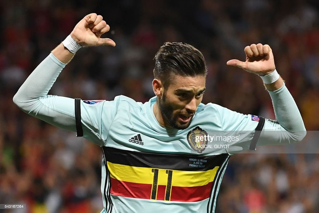 TOPSHOT - Belgium's forward Yannick Ferreira-Carrasco celebrates after scoring his team's fourth goal during the Euro 2016 round of 16 football match between Hungary and Belgium at the Stadium Municipal in Toulouse on June 26, 2016. /