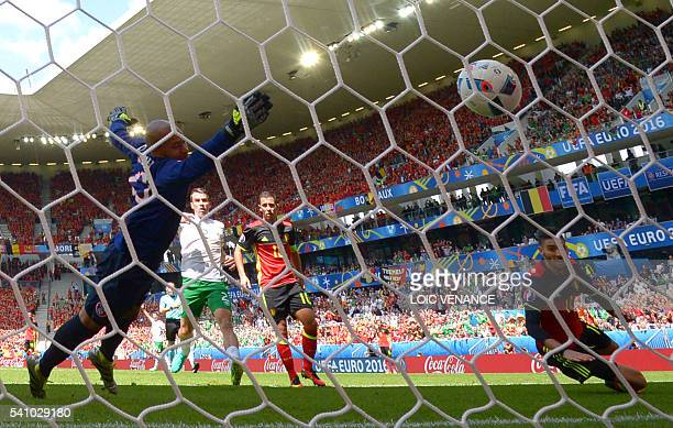 TOPSHOT Belgium's forward Yannick FerreiraCarrasco scores a goal that was ruled offside during the Euro 2016 group E football match between Belgium...