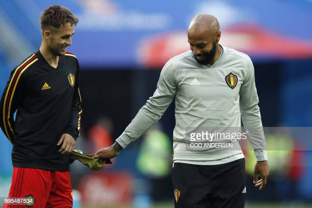 Belgium's French assistant coach Thierry Henry gestures past Belgium's forward Adnan Januzaj during Belgium's warmup before the Russia 2018 World Cup...
