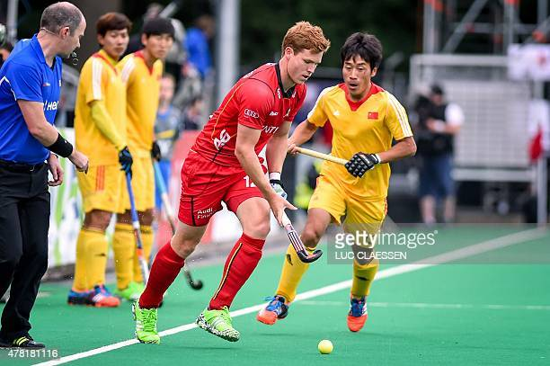 Belgium's Gauthier Boccard competes with China's Yang Ao during the field hockey match between Belgium and China in the Group B of the men's group...
