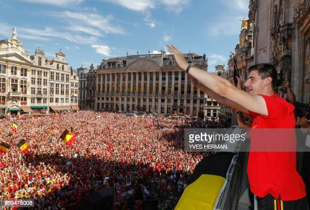 Belgium's goalkeeper Thibaut Courtois celebrates at the balcony in front of more than 8000 supporters at the GrandPlace Grote Markt in Brussels city...
