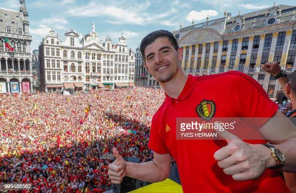 Belgium's goalkeeper Thibaut Courtois celebrates at the Grand Place/Grote Markt in Brussels city center, as Belgian national football team Red Devils...