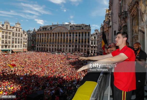 Belgium's goalkeeper Thibaut Courtois celebrates on the balcony in front of more than 8000 supporters at the Grand Place/Grote Markt in Brussels city...