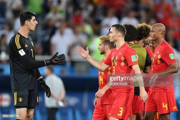 Belgium's goalkeeper Thibaut Courtois celebrates with Belgium's defender Thomas Vermaelen at the end of the Russia 2018 World Cup Group G football...
