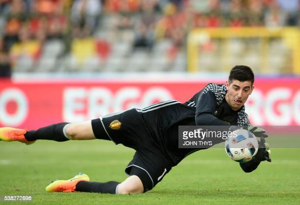 Belgium's goalkeeper Thibaut Courtois controls the ball during the friendly football match between Belgium and Norway at the King Baudouin Stadium on...