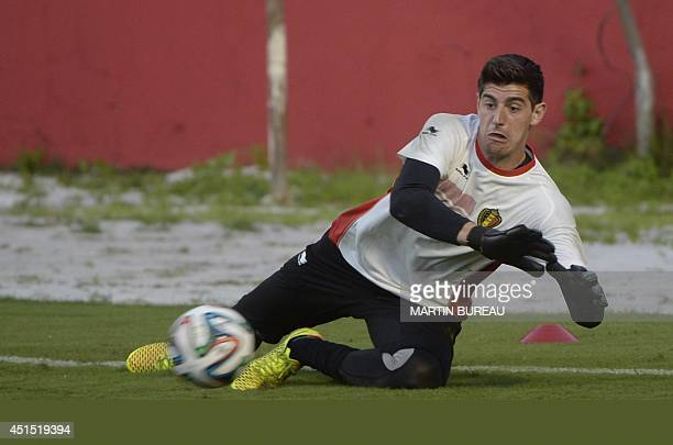 Belgium's goalkeeper Thibaut Courtois grabs the ball during a training session in Salvador on June 30 during the 2014 FIFA World Cup football...