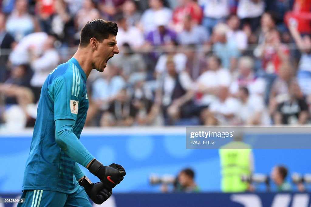 TOPSHOT - Belgium's goalkeeper Thibaut Courtois reacts after Belgium's forward Eden Hazard scored during their Russia 2018 World Cup play-off for third place football match between Belgium and England at the Saint Petersburg Stadium in Saint Petersburg on July 14, 2018. (Photo by Paul ELLIS / AFP) / RESTRICTED