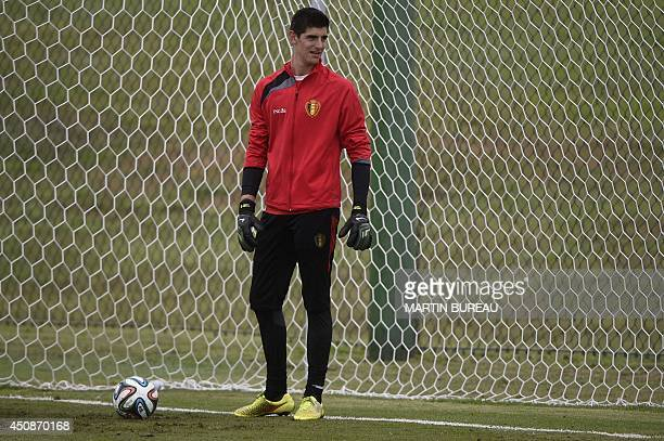 Belgium's goalkeeper Thibaut Courtois takes part in a training session during the 2014 FIFA World Cup football tournament in Mogi das Cruzes on June...