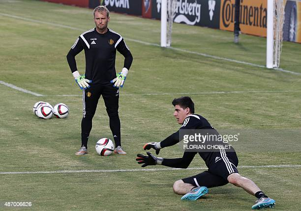 Belgium's goalkeepers JeanFranois Gillet and Thibaut Courtois take part in a training session at the GSP stadium in the Cypriot capital Nicosia on...