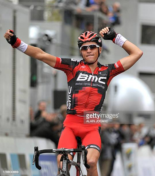 Belgium's Greg Van Avermaet celebrates raises his arms in victory as he crosses the finish line of the ParisTours cycling race on October 9 2011 in...