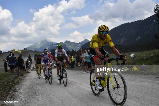 Belgium's Greg Van Avermaet , wearing the overall leader's yellow jersey, rides with a breakaway group in the ascent of the Plateau des Glieres...