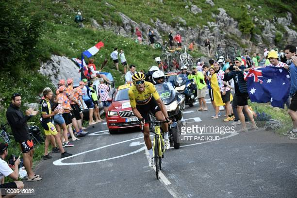 Belgium's Greg Van Avermaet wearing the overall leader's yellow jersey rides up the Colombiere pass during the tenth stage of the 105th edition of...