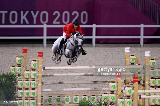Belgium's Gregory Wathelet riding Nevados S competes in the equestrian's jumping individual finals during the Tokyo 2020 Olympic Games at the...