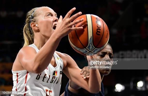 Belgium's guard Julie Allemand vies with France's forward Endene Miyem during the FIBA 2018 Women's Basketball World Cup quarter final match between...