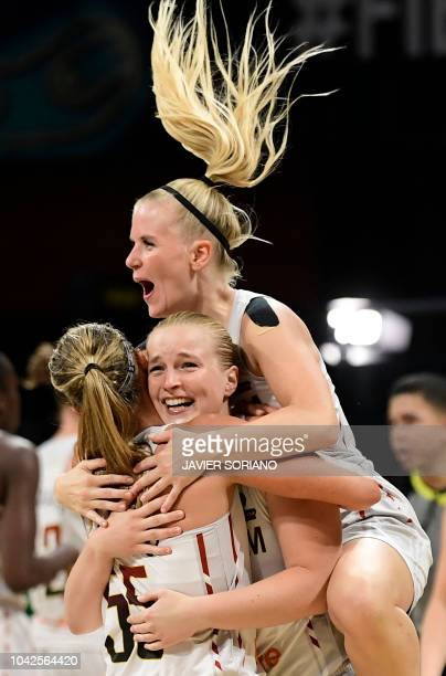 Belgium's guard Julie Vanloo celebrates her team's win with teammates at the end of the FIBA 2018 Women's Basketball World Cup quarter final match...