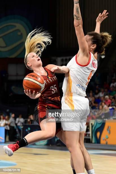 Belgium's guard Julie Vanloo vies with Spain's forward Laura Nicholls during the FIBA 2018 Women's Basketball World Cup third place final match...