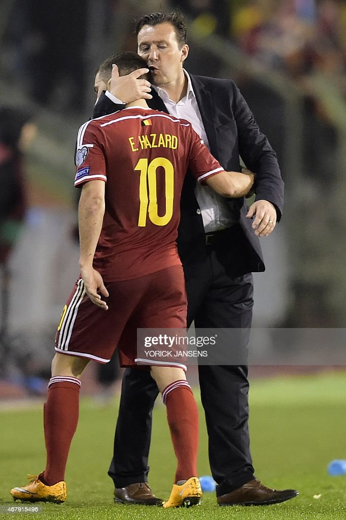 Belgium's head coach Marc Wilmots (R) embraces Belgium's Eden Hazard during the Euro 2016 qualifying round football match between Belgium and Cyprus at the King Baudouin stadium in Brussels on March 28, 2015.