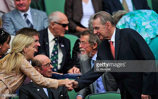 Belgium's Jacques Rogge Pesident of the International Olympic Committee shakes hands with Lady Nicholas Windsor in the Royal Box on Centre Court...